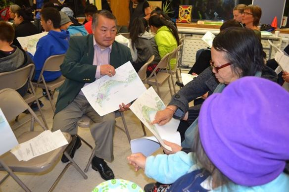Hmong interpreter assists residents at the community meeting.